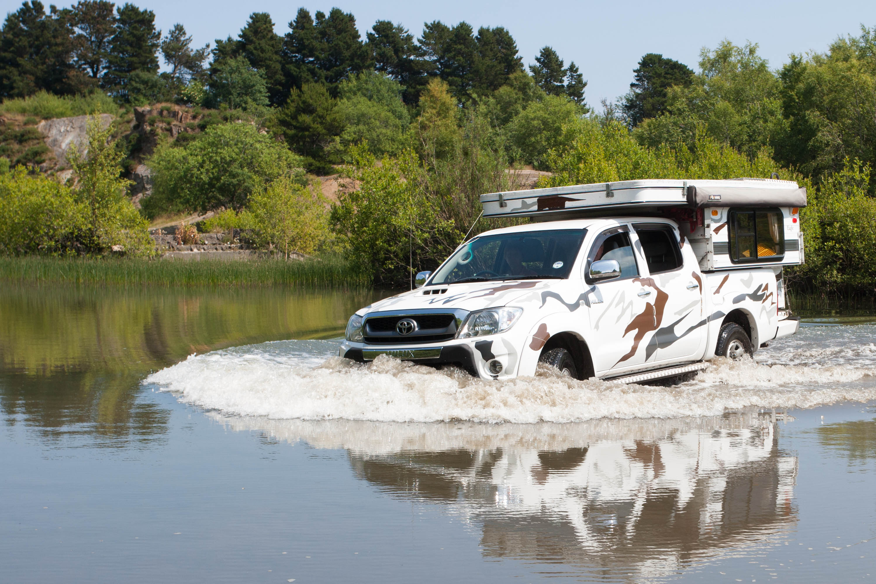 Paula drives through water which is no problem at all to the Toyata Hilux